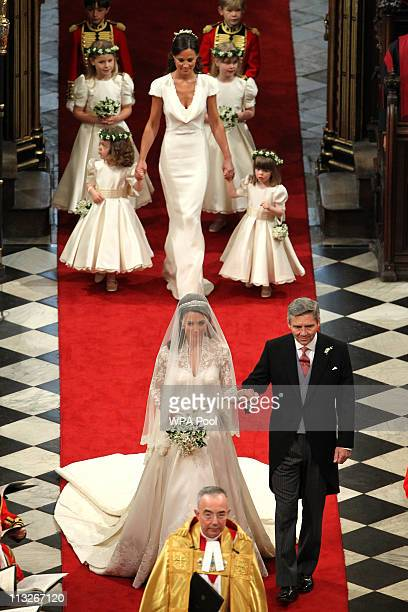 Father of the bride Michael Middleton leads his daughter Catherine down the aisle to be wed to Prince William followed by Pippa Middleton during...
