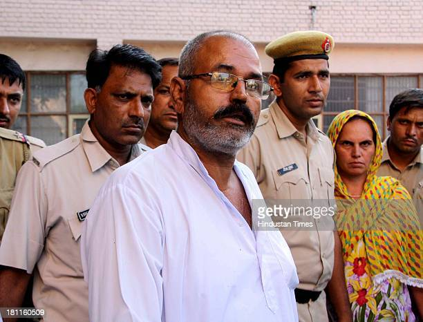 Father of the victim girl and main accused Narender alias Billu is being taken to court in case of honor killing on September 19 2013 in Rohtak India...