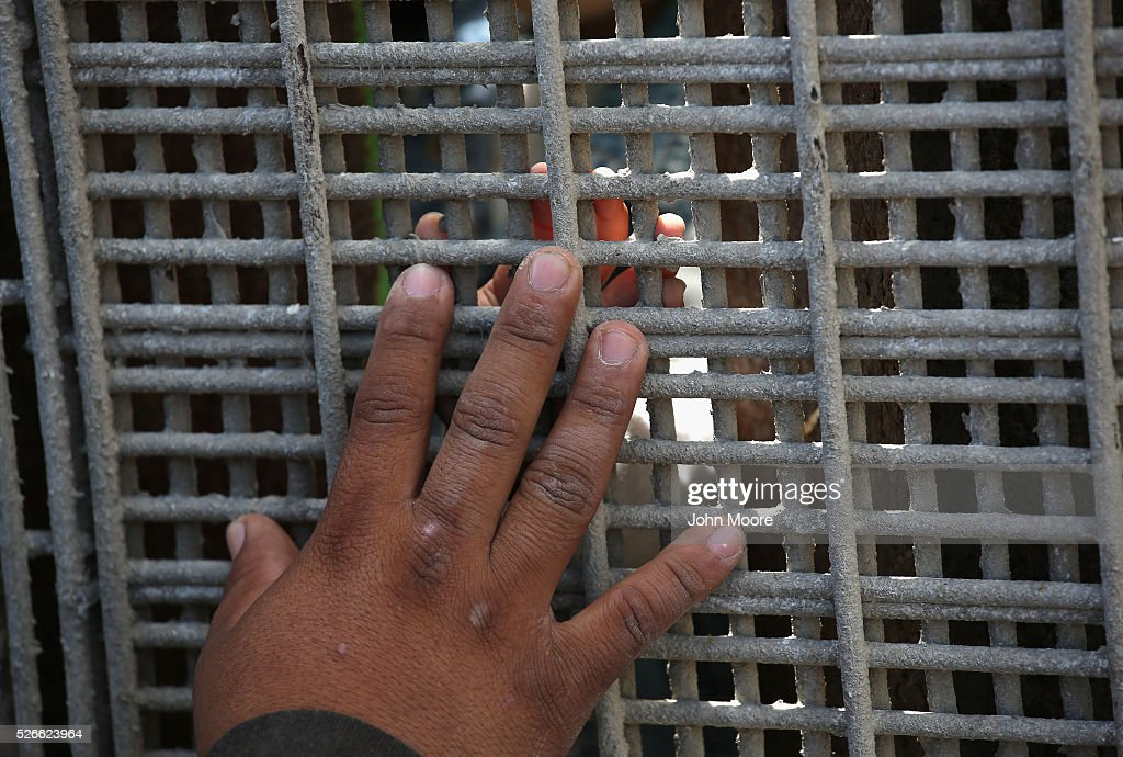 A father on the American side of the border tries to touch his son's hand through the U.S.-Mexico Border fence during a 'Opening the Door of Hope' event on April 30, 2016 in San Diego, California. Five families, with some members living in Mexico and others in the United States, were permitted to meet and embrace for three minutes each at a door in the fence, which the U.S. Border Patrol opened to celebrate Mexican Children's Day. It was only the third time the fence, which separates San Diego from Tijuana, had been opened for families to briefly reunite. The event was planned by the immigrant advocacy group Border Angels.