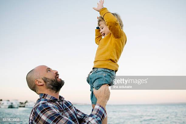 Father palying wiht his son at beach