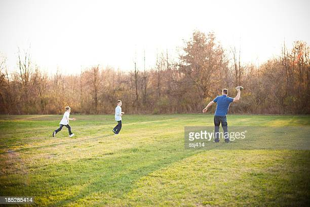 Father Playing football with his Sons