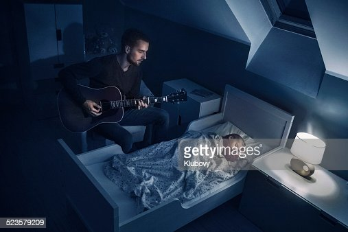 Father playing lullabies to his daughter