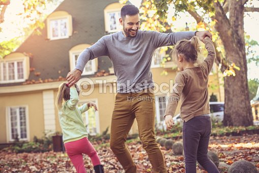 Father playing with daughter at backyard. : Stock Photo