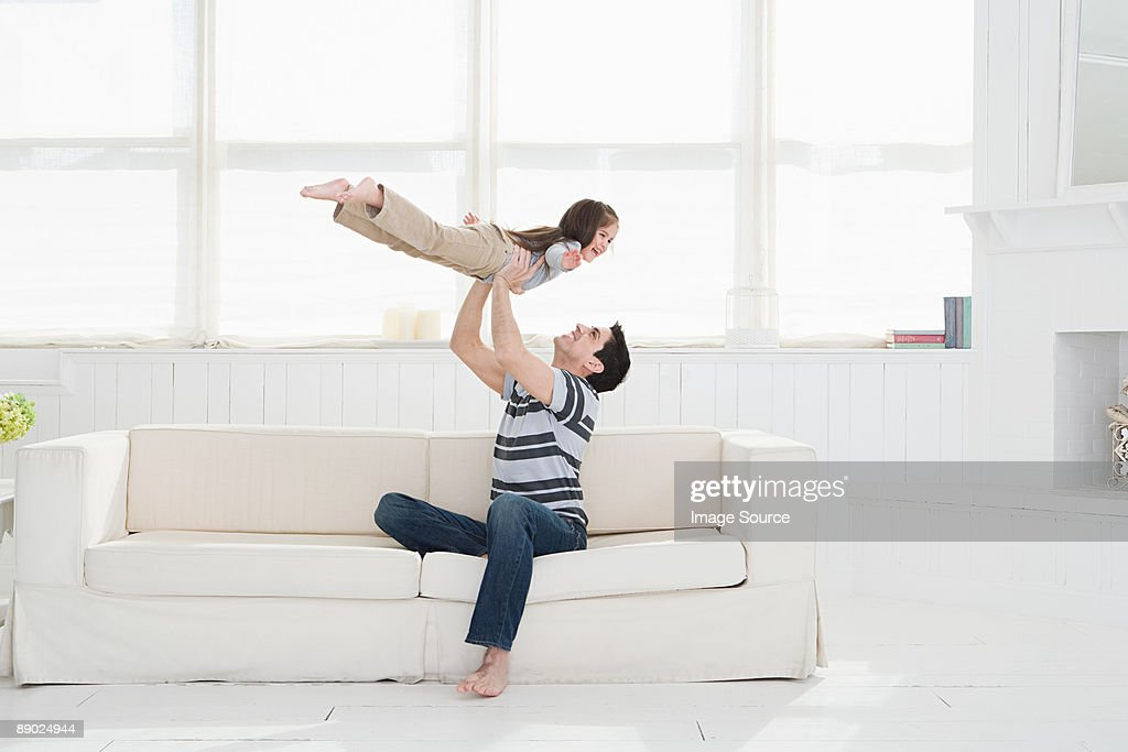 Father playing with daughter : Stock Photo