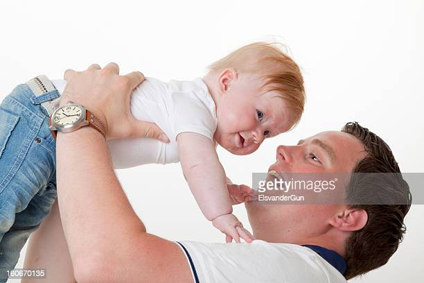 father playing with his baby son