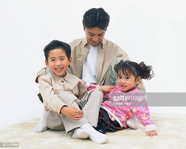 A father playing with his children