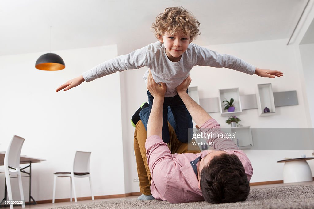 Father playing with son at home : Photo