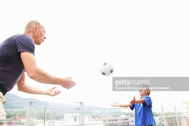 Father playing with son outdoors