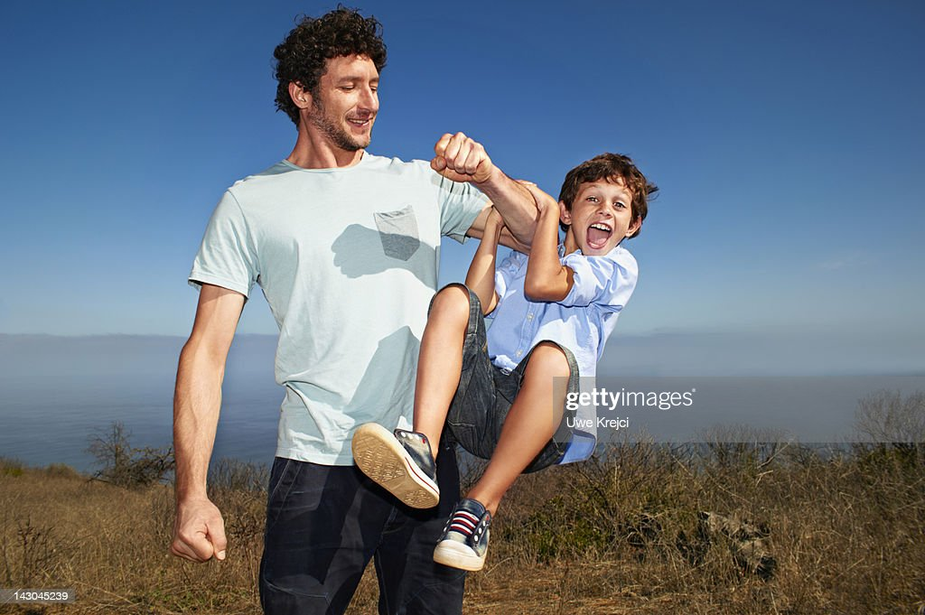 Father playing with son (6 - 8) : Stock Photo