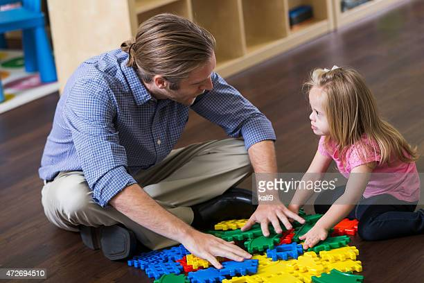 Father playing with special needs child