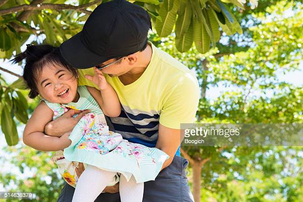 Father Plays Outside with Little Daughter