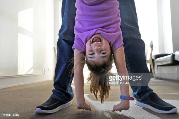 Father plays with his daughter at home