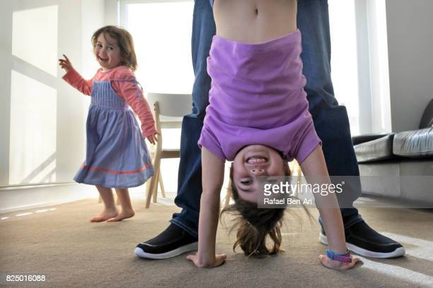 Father plays with his daughters at home