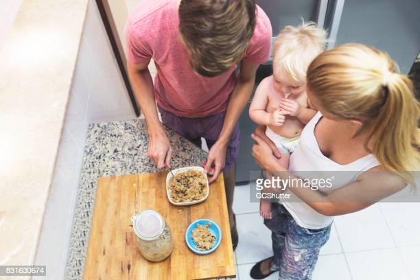 Father preparing food for the hungry baby in the morning