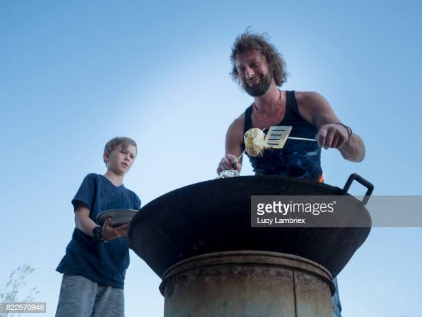 Father preparing food with his son