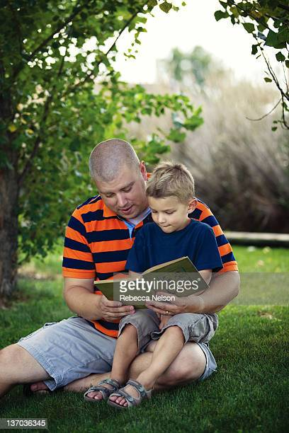 Father reading book with his son