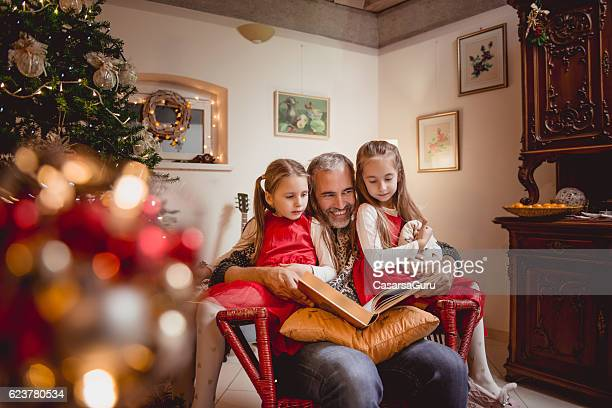 Father reading Fairy tales on Christmas