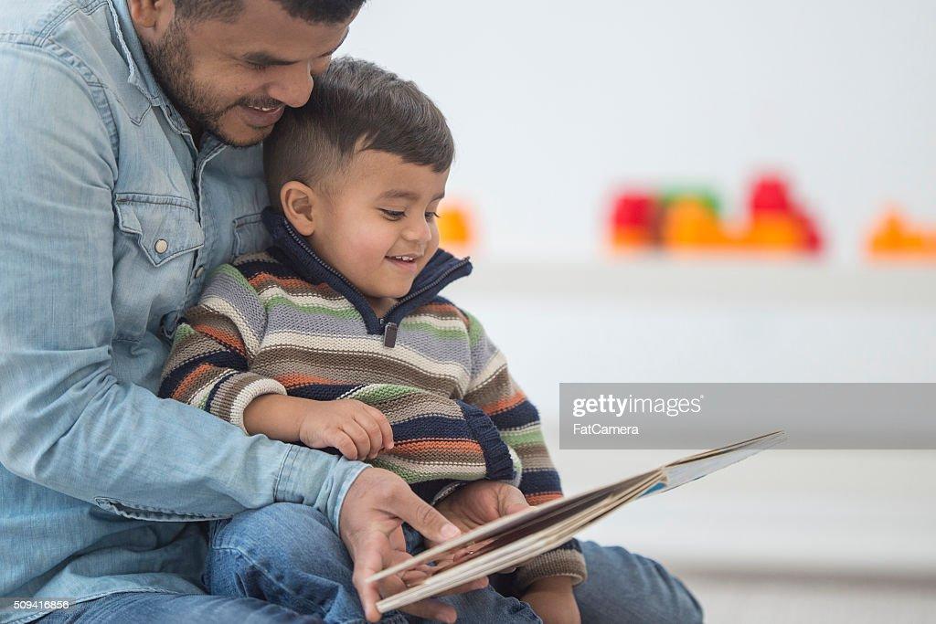 Father Reading His Son a Book : Stock Photo