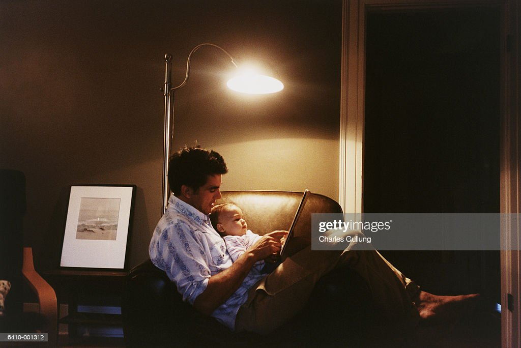 Father Reading to Baby : Stock Photo
