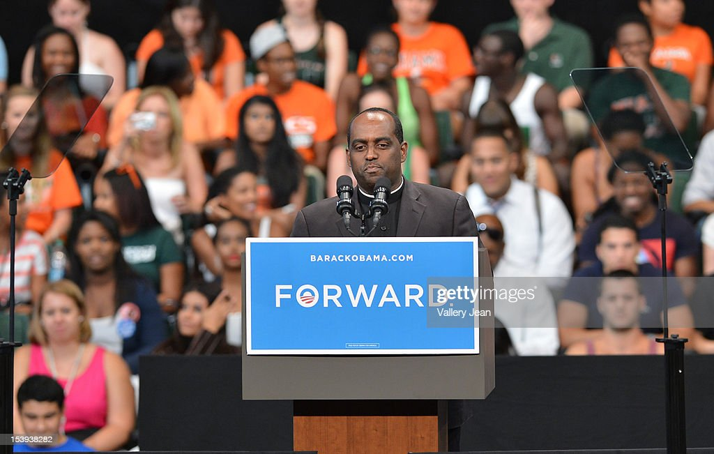 Father Reginald Jean-Mary gives the invocation at a grassroots event with President Obama at Bank United Center on October 11, 2012 in Miami, Florida.