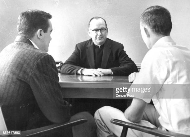Father Richard Ryan president of Regis College confers with two members of the allmale student body in his office in Main Hall Discussing student...