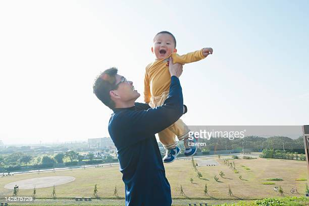 Father rises his boy up