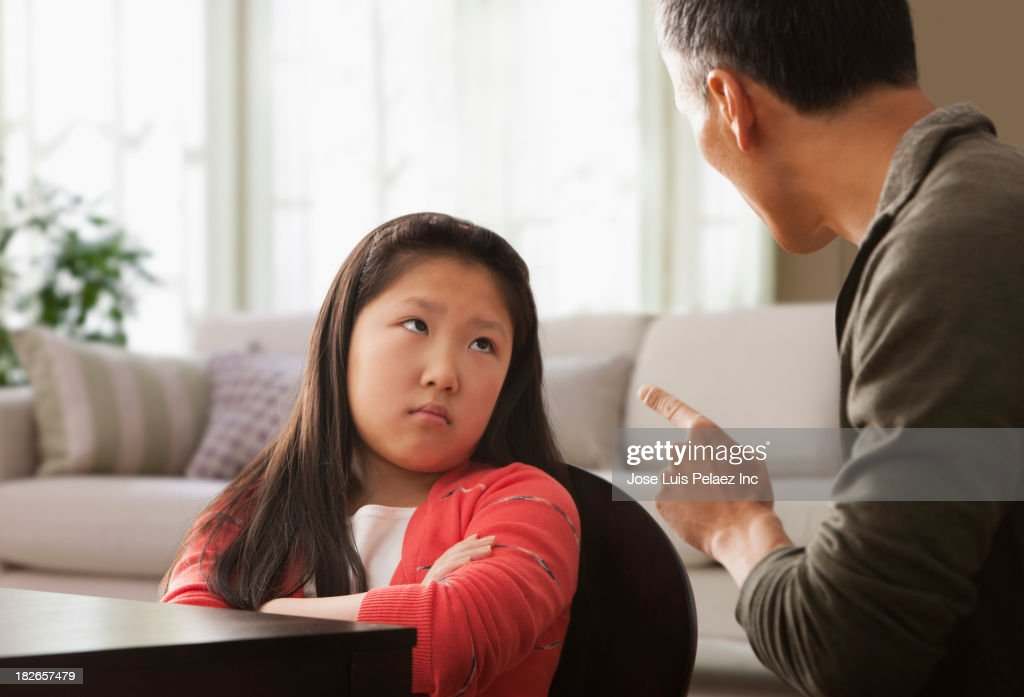 Father scolding pouting daughter : Stock Photo