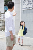 Father sending daughter to school