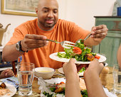 Father Serving Salad on a Plate