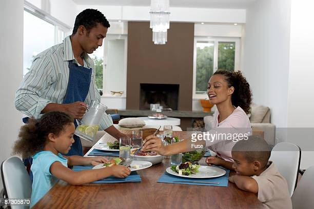 Father Setting the Dining Table with Family