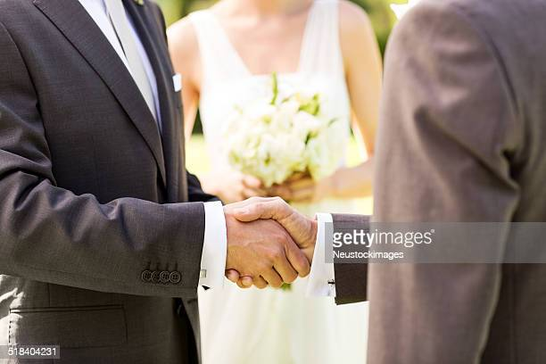 Father Shaking Hands With Groom At Garden