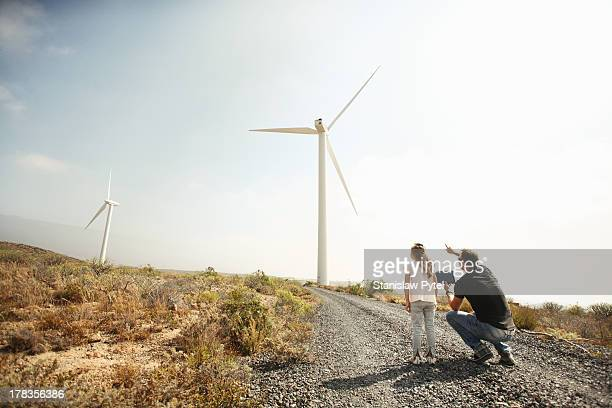 Father showing daughter windmills