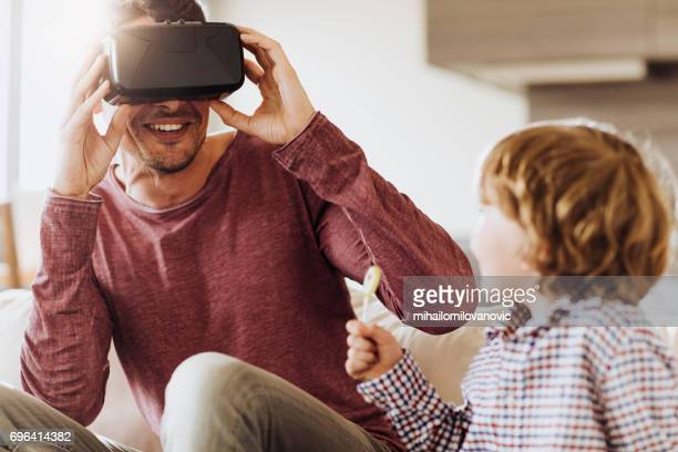 Father showing his son how to use VR