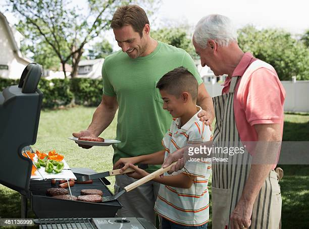 Father son and grandson at the grill