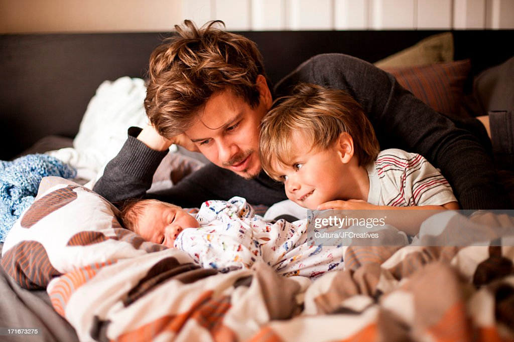 Father, son and newborn baby : Stock Photo