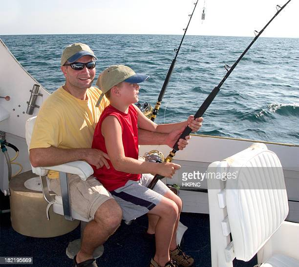 Father & Son (boy) On Charter Fishing Boat