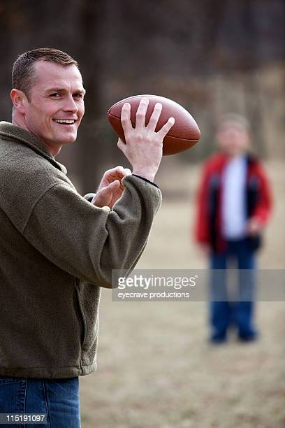 father son outdoor football