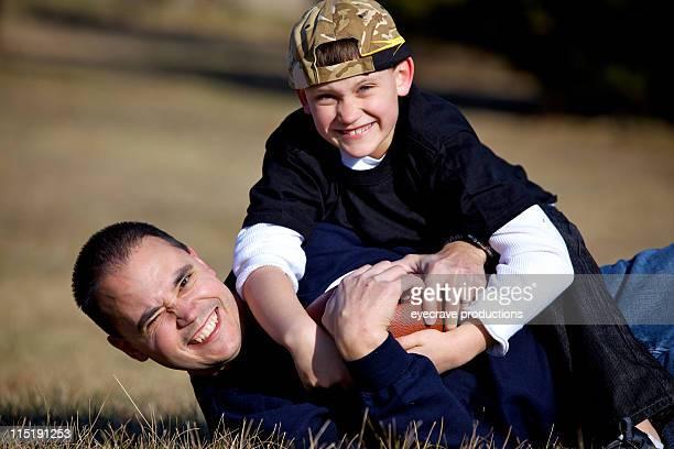 father son outdoor football