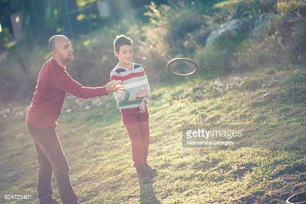 Father Son Playing Hoop and pole (Quoits) or Chunkee game