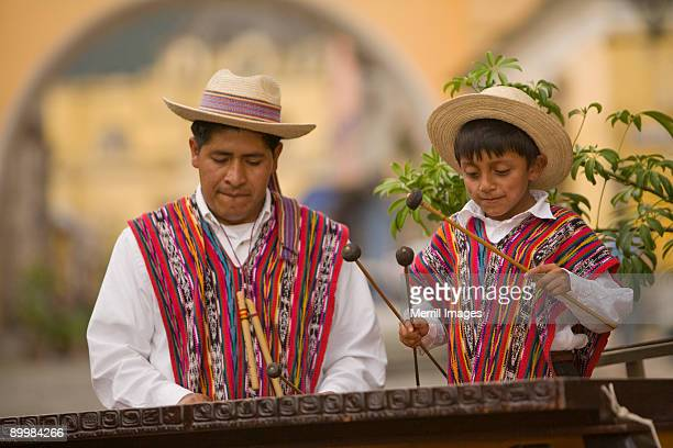 Father & son playing Marimba together