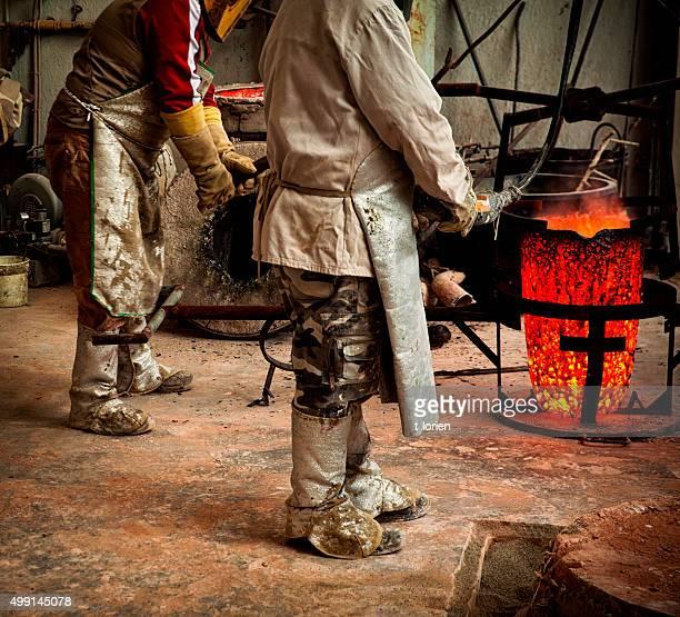 Father & Son preparing for bronze casting.