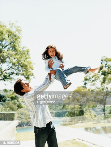 Father Swinging His Daughter in the Air : Foto stock