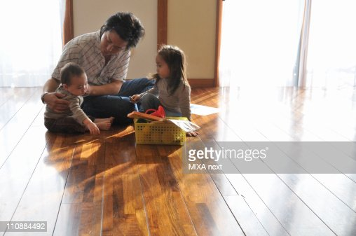 Father Taking Care of Daughters : Stock Photo