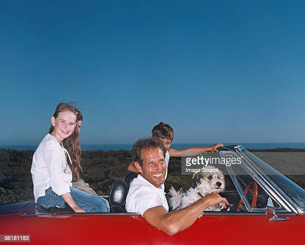 Father taking children and dog on a road trip