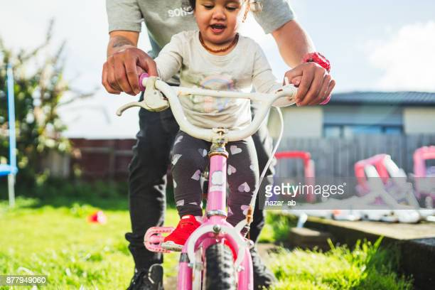 Father taking daughter for a ride.