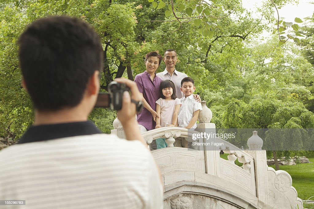 Father Taking Photo in Ditan Park : Stock Photo