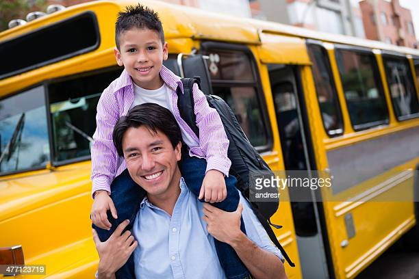 Father taking son to the school bus