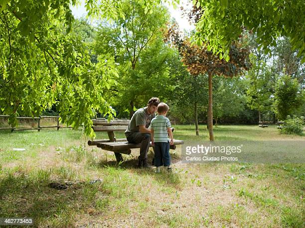 Father talking with his son in the park
