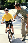 Father Teaching His Son How to Ride a Bicycle