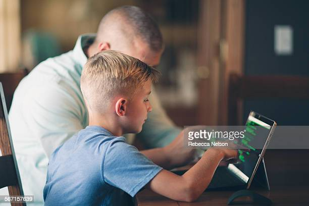 father teaching son how to code